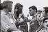 Raymond Poulidor (1936-2019), coureur cycliste français et Jean Leulliot (1911-1982), journaliste et organisateur de courses cyclistes français, lors du Tour de France. Photographie d'André Perlstein (né en 1942). 2 juillet 1969. © André Perlstein / Roger-Viollet