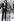 Couple à la mode des années soixante-dix, avenue des Champs-Elysées. Photographie d'André Perlstein (né en 1942). Paris (VIIIème arr.), 1970. © André Perlstein / Roger-Viollet