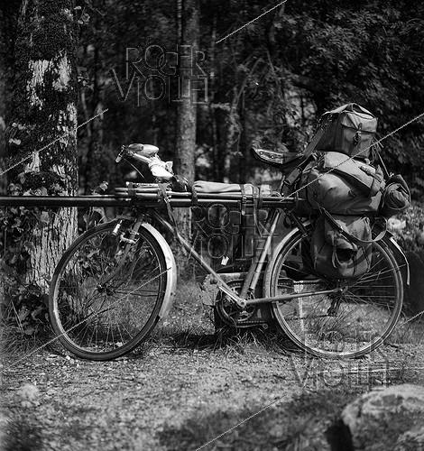 Roger-Viollet | 783181 | A fisher's bike loaded with all his equipment. | © Tony Burnand / Roger-Viollet