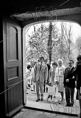 Roger-Viollet | 1009171 | Christening of Anthony Delon, Alain Delon and Nathalie's son, on May 1st, 1966. Photograph by Georges Kelaïditès (1932-2015). | © Georges Kelaïditès / Roger-Viollet