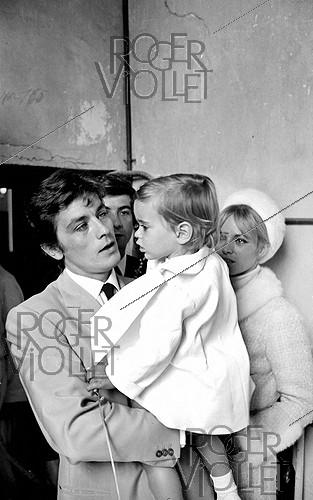 Roger-Viollet | 454749 | Christening of Anthony Delon, Alain Delon and Nathalie's son, on May 1st, 1966. Photograph by Georges Kelaïditès (1932-2015). | © Georges Kelaïditès / Roger-Viollet