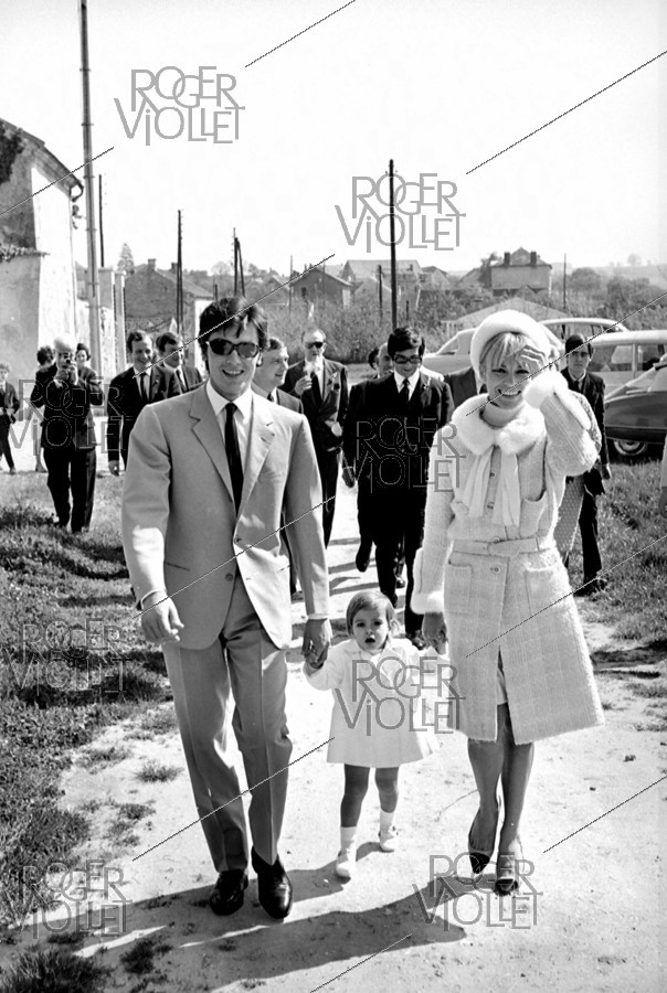 Roger-Viollet | 482424 | Christening of Anthony Delon, son of Alain Delon and Nathalie, on May 1st, 1966. Photograph by Georges Kelaïditès (1932-2015). | © Georges Kelaïditès / Roger-Viollet