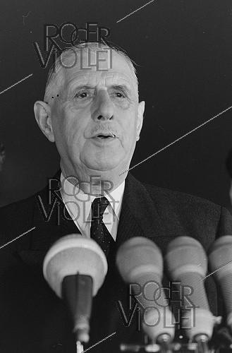 Roger-Viollet | 1115468 | Events of May-June 1968. General Charles de Gaulle (1890-1970), President of the French Republic, returning to France after an official visit in Romania. Bucarest (Romania), on May 18, 1968. Photograph by Bernard Charlet, from the collections of the French newspaper  France-Soir . Bibliothèque historique de la Ville de Paris. | © Bernard Charlet / Fonds France-Soir / BHVP / Roger-Viollet