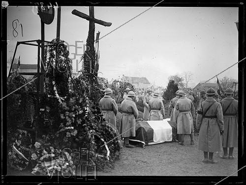 Roger-Viollet | 1283801 | Funeral of the seven brothers in arms of the Unknown Soldier, following the designation ceremony by Auguste Thin (1899-1982), Corporal from the 132th regiment of the French infantry. The caskets leaving the chapel of the Verdun citadel to be burried at the Faubourg-Pavé national necropolis, on November 10, 1920. Photograph from the collections of the newspaper  Excelsior . | © Excelsior - L'Equipe / Roger-Viollet