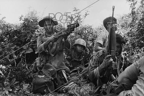 Roger-Viollet | 961813 | Government soldiers fighting against the  Khmer Rouge . Cambodia, 1975. | © Françoise Demulder / Roger-Viollet