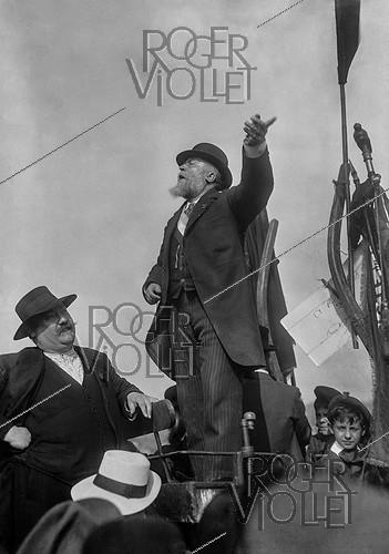 Roger-Viollet | 308327 | Jean Jaures (1859-1914), French politician, making a speech during the rally against the Three Year Law, in the presence of Pierre Renaudel, on the left, one of the founders of the French socialist party. Le Pré-Saint-Gervais (France), on May 25, 1913. | © Maurice-Louis Branger / Roger-Viollet