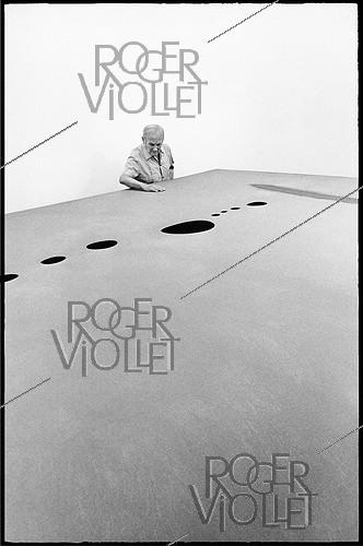Roger-Viollet | 1376459 | Joan Miro (1893-1983), Spanish painter, sculptor, engraver and ceramist. One of the creators of the surrealism movement. Attending his exhibition at the Fondation Maeght. Saint-Paul de Vence (France), on July 21, 1968. Photograph by André Perlstein (born in 1942). | © André Perlstein / Roger-Viollet