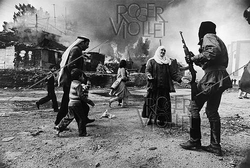 Roger-Viollet | 600637 | Lebanese Civil War (1975-1990). In January, the Christian Falangists attacked Palestinians who took refuge in barracks of the Quarantine district since 1947. With this photograph, Françoise Demulder was the first woman to get the biggest award: the World Press in 1977. Beirut (Lebanon), on January 19, 1976. | © Françoise Demulder / Succession Demulder / Roger-Viollet
