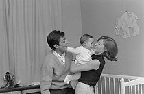 Roger-Viollet | 1283333 | Nathalie Delon (born in 1941) and Alain Delon (born in 1935) playing with their son Anthony Delon (born in 1964). France, on April 28, 1965. Photograph by Jean Laborie (1928-2014), from the collections of the newspaper