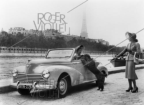 Roger-Viollet | 237824 | Paris, Car show. Model 203 Peugeot. Convertible top, 2 seats. Paris, October 1951. | © Jacques Boyer / Roger-Viollet