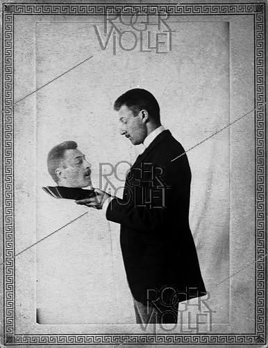 Roger-Viollet | 1011629 | Photographic effect. Henri Roger holding his head on a dish, May 1892. Photograph by Henri Roger (1869-1946). | © Henri Roger / Roger-Viollet