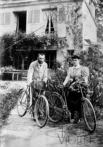 Roger-Viollet | 775416 | Pierre and Marie Curie, French physicists, leaving on bicycle, in 1896. | © Jacques Boyer / Roger-Viollet
