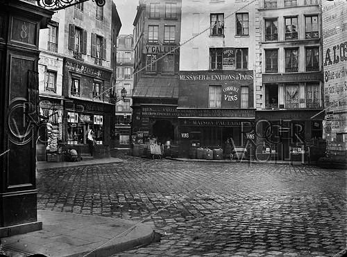 Roger-Viollet | 241387 | Place Sainte-Opportune, from the rue des Fourreurs. Paris (Ist arrondissement), 1864-1867. Photograph by Charles Marville (1813-1879). Bibliothèque historique de la Ville de Paris. | © Charles Marville / BHVP / Roger-Viollet