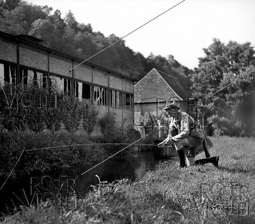 Roger-Viollet | 768740 | Tony Burnand (1892-1969), French photographer and writer, fly fishing in Normandy, 1946. | © Tony Burnand / Roger-Viollet