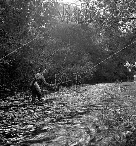 Roger-Viollet | 775669 | Tony Burnand (1892-1969), French photographer and writer, fly fishing in Brittany, 1945-1946. | © Tony Burnand / Roger-Viollet