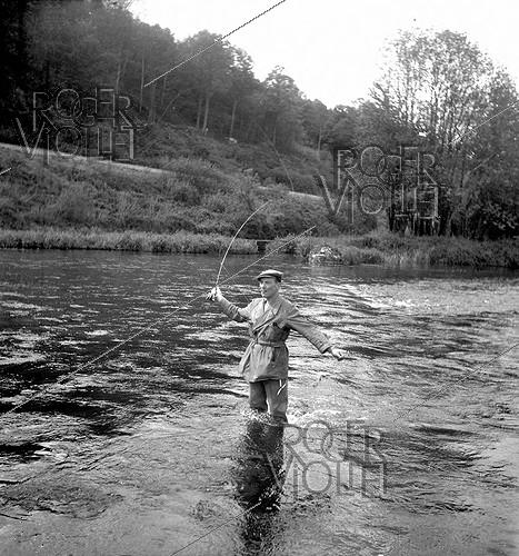 Roger-Viollet | 983799 | Tony Burnand (1892-1969), French photographer and writer, fly fishing, 1946. | © Tony Burnand / Roger-Viollet
