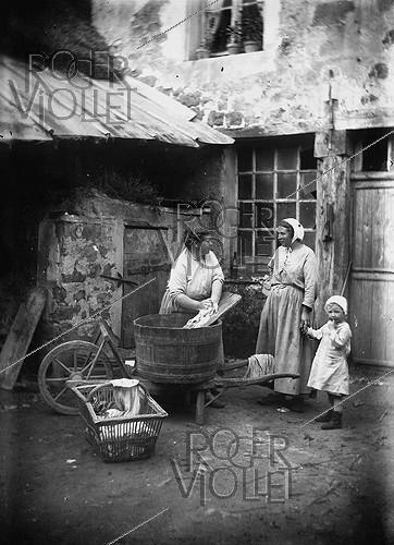 Roger-Viollet | 470330 | Woman doing the washing. France, around 1900. | © Albert Harlingue / Roger-Viollet
