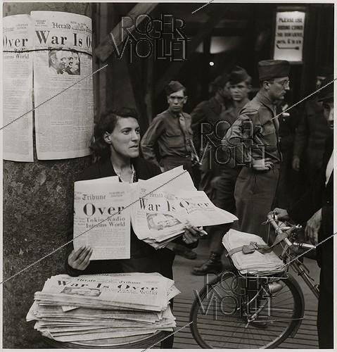 Roger-Viollet | 816274 | Woman selling newspapers  The Herald Tribune  with the headline  War is Over , boulevard de la Madeleine. Paris (Ist, VIIIth or IXth arrondissements), 1945. Photograph by Roger Schall (1904-1995). Paris, musée Carnavalet. | © Roger Schall / Musée Carnavalet / Roger-Viollet