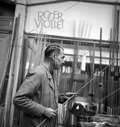 Roger-Viollet | 1065330 | Worker at the Etablissements Pezon et Michel, manufacture for fishing rods. Amboise (Indre-et-Loire), circa 1945. | © Tony Burnand / Roger-Viollet