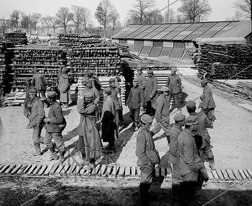 Roger-Viollet | 611378 | World War I. German prisoners at a sawmill. | © Jacques Boyer / Roger-Viollet