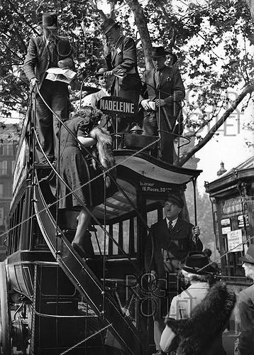 Roger-Viollet | 659614 | World War II. Madeleine-Bastille double decker bus, near the Paris Opera, on June 17, 1941. | © LAPI / Roger-Viollet