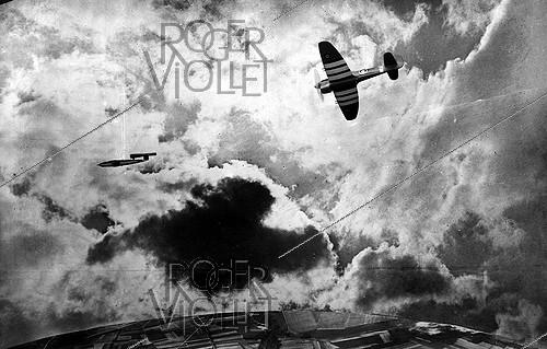 Roger-Viollet | 248529 | World War II. English airplane trying to destroy a V1 rocket in flight. Photomontage. | © LAPI / Roger-Viollet