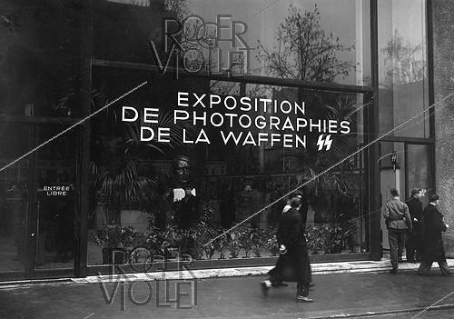 Roger-Viollet | 438869 | World war II. Exhibition of photographs of the French Waffen SS. Paris, Champs-Elysées, January 1944. | © LAPI / Roger-Viollet