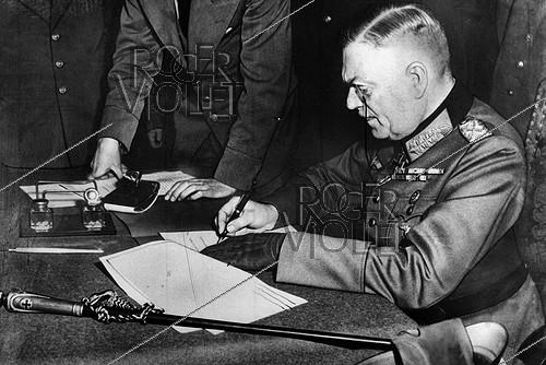 Roger-Viollet | 844732 | World War II. German Marshal Wilhelm Keitel signing the unconditional surrender of Germany. Berlin military academy (Germany), on May 9, 1945. | © Neurdein / Roger-Viollet