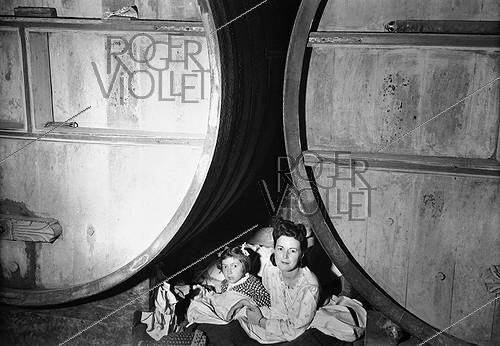 Roger-Viollet | 945705 | World War II. Inhabitants of Maintenon (Eure-et-Loir) taking refuge in a cellar, during American air raids aiming at German warehouses of ammunitions. June 1944. | © Pierre Jahan / Roger-Viollet