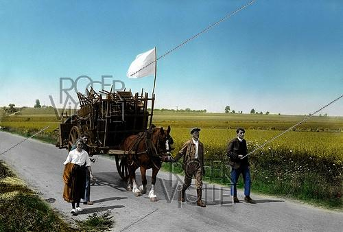 Roger-Viollet | 836194 | World War II. Landing of Normandy. Exodus of population of Falaise-Argentan. August 1944. Colourized picture. | © Roger-Viollet / Roger-Viollet