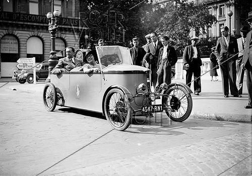 Roger-Viollet | 559066 | World War II.  Le Dauphin  electric car. Paris, September 1941. | © LAPI / Roger-Viollet