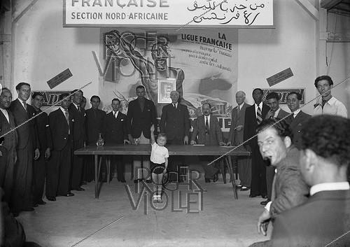 Roger-Viollet | 432892 | World War II. Meeting of the Paris North African section of the French League founded by Pierre Costantini, in March 1941. | © LAPI / Roger-Viollet
