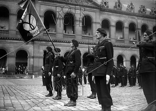 Roger-Viollet | 560843 | World War II. Militia Oath ceremony. Paris, Cour des Invalides, July 1st, 1944. | © LAPI / Roger-Viollet