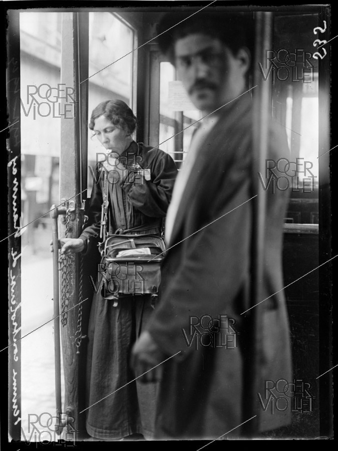 Roger-Viollet | 1061737 | World War One. Woman checking tickets in a streetcar, early September 1914. | © Caudrilliers / Excelsior - L'Equipe / Roger-Viollet