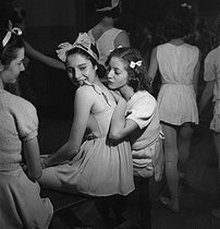 Roger-Viollet | 729633 | Young dancers in the wings of the Paris Opera, late 1930s. | © Gaston Paris / Roger-Viollet