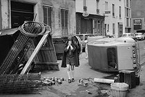 """Events of May-June 1968. A devasted street, aftermath of the """"Night of the barricades"""". Paris, on May 11, 1968. Photograph by Jacques Boissay, from the collections of the French newspaper """"France-Soir"""". Bibliothèque historique de la Ville de Paris. © Jacques Boissay / Fonds France-Soir / BHVP / Roger-Viollet"""