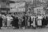 Front populaire. Défilé du syndicat C.G.T. des femmes de ménage, laveurs de carreaux, etc. Paris, 14 juillet 1936. © Collection Roger-Viollet/Roger-Viollet