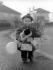 Petit garçon et ses cadeaux de Noël. Grande-Bretagne, 25 décembre 1934. © TopFoto/Roger-Viollet