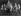 Enfants, déguisés en lutins, dansant autour d'un arbre de Noël. Danemark, 29 novembre 1965. © TopFoto/Roger-Viollet