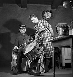 Jeune femme et garde champêtre. France, vers 1935. © Gaston Paris / Roger-Viollet