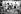 """Tournage des """"Demoiselles de Rochefort"""". Jacques Demy, metteur en scène, Agnès Varda, Michel Legrand et Catherine Deneuve. France, 1966. Photographie de Georges Kelaïditès (1932-2015). © Georges Kelaïditès / Roger-Viollet"""