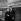 """Jean-Paul Belmondo et Christine Kaufmann, pendant le tournage de """"Un nommé La Rocca"""" de Jean Becker. France, 1961.   © Alain Adler/Roger-Viollet"""