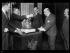 """Le sceau de la République française est apposé sur le traité de Versailles, le 21 octobre 1919. Photographie parue dans le journal """"Excelsior"""" du mercredi 22 octobre 1919. © Excelsior - L'Equipe / Roger-Viollet"""