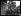 """Guerre 1914-1918. Les grèves parisiennes au sujet de la semaine anglaise et contre la vie chère, fin mai 1917 : après les couturières et les modistes, beaucoup de corsetières et de fourreuses ont cessé de travailler. """"Les grévistes de l'aiguille au Palais-Bourbon : les grilles ont été fermées. Portée par ses camarades, une gréviste expose à des députés les revendications des petites ouvrières"""". © Excelsior – L'Equipe/Roger-Viollet"""