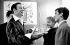 Alain Delon et Romy Schneider dans la loge d'Yves Montand au théâtre de l'Etoile. Paris, 9 octobre 1958. © Bernard Lipnitzki / Roger-Viollet