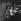 """Le réalisateur Marc Allegret dirigeant Pierre Brasseur dans son film """"L'Abominable homme des douanes"""". Juillet 1962.        © Alain Adler / Roger-Viollet"""