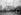Le cercueil du Soldat inconnu passant place Denfert-Rochereau avant son inhumation sous l'Arc de Triomphe. Paris (VIIIème arr.), 11 novembre 1920. © Albert Harlingue/Roger-Viollet