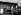 Guerre 1939-1945. Groupe de soldats allemands regardant la vitrine d'un marchand de souvenirs, place du Tertre, dans le quartier de Montmartre. Paris (XVIIIème arr.), vers 1942. © Roger-Viollet