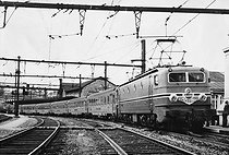 """The """"Mistral"""" electric locomotive used on the Paris-Lyon train line of the SNCF, French railway company. France, 1958. © Jacques Boyer / Roger-Viollet"""