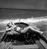 Femme. Plage de Deauville (Calvados), août 1950. © Boris Lipnitzki/Studio Lipnitzki/Roger-Viollet